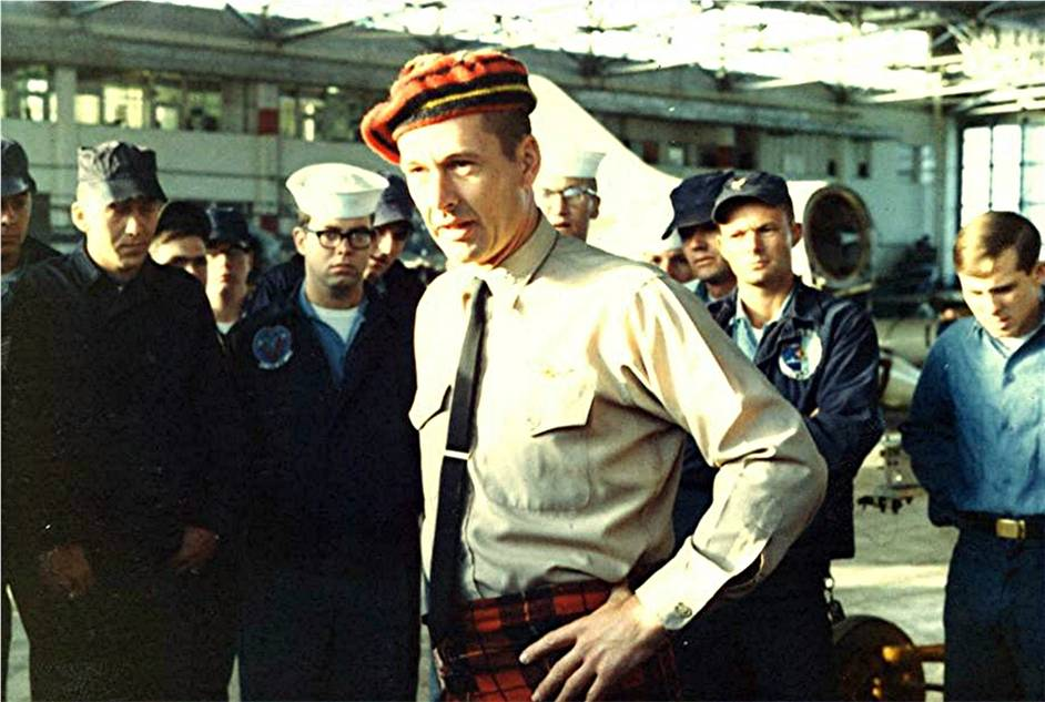 Squadron Commanding Officer Fred Dunning wearing a tartan tam-o-shanter and kilt while speaking to squadron members at NAS Cecil Field, Jacksonville, Florida, 1967.