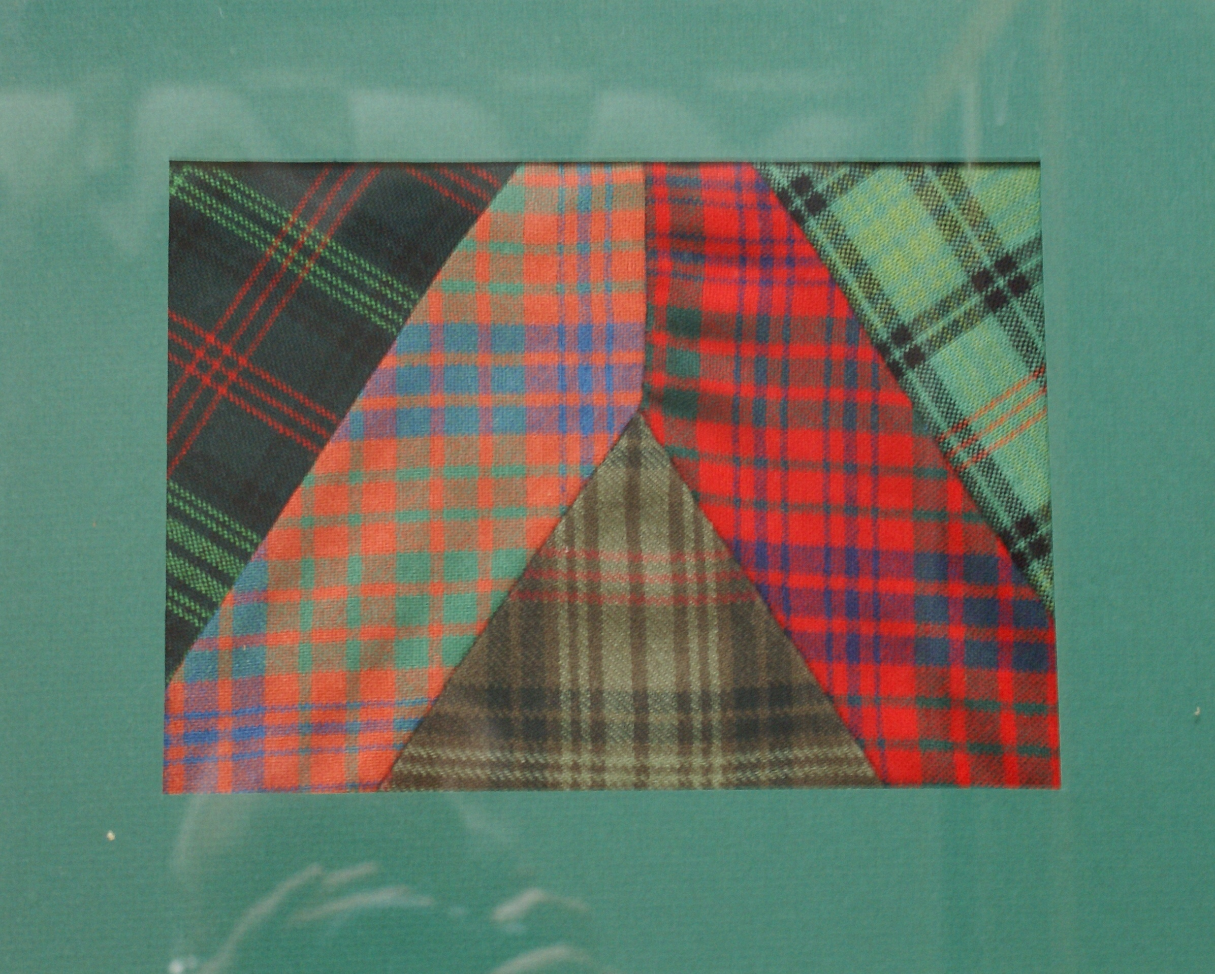 Ross Tartans in Space. From left to right: Ross hunting tartan (modern), Ross tartan (ancient), weathered Ross hunting tartan, Ross tartan (modern) and the Ross hunting tartan (ancient). Photo courtesy of George Ross, Clan Ross (Netherlands).